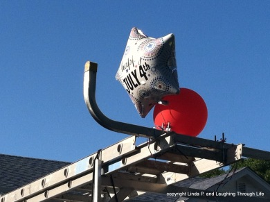 Fourth of July Balloons on a construction ladder_photo