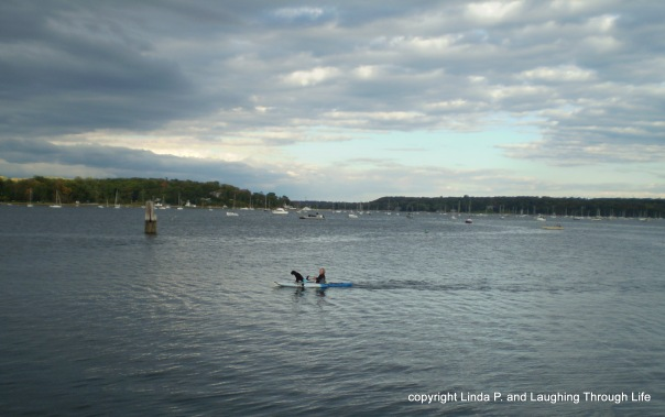 Guy kayaking with his dog
