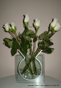 Roses in clear vase with glass stones