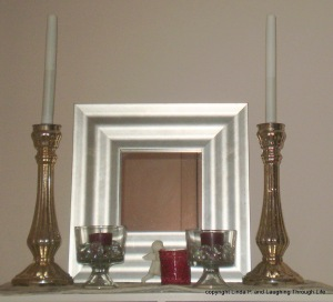 clear stones in candleholders on a bookcase