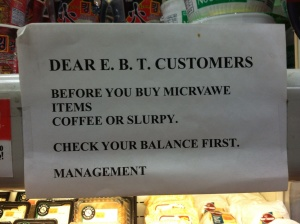 Gas station deli sign asking EBT customers to be mindful of their balances