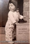 Picture of me as a baby with my hands on a Dellwood Dairy Products milk box