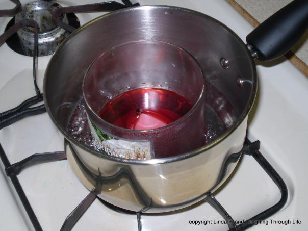 wax afloat in a jar afloat in a pan of simmering water