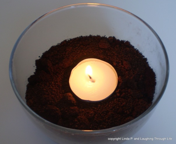 tealight in a dish of coffee grounds