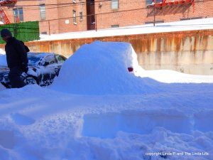 Car in the snow. Shovel in the car.