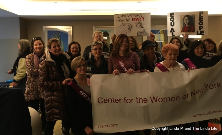 Marchers with the Center for the Women of New York assemble before marching on 1-21-17