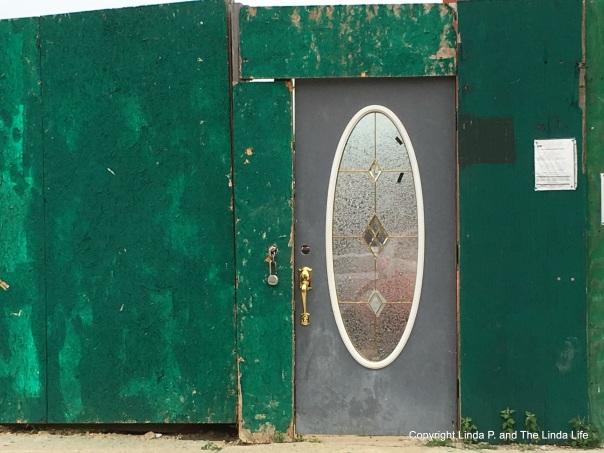 Door to a construction site 7-13-17 in Queens