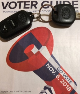 2018 NYC voter guide with car key and clicker